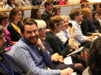 Audience members at a conference